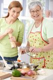 Happy mother and daughter cooking together royalty free stock images