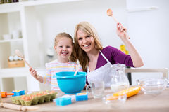 Happy mother and daughter cooking together Royalty Free Stock Photography