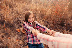 Happy mother and daughter on cozy walk on sunny field. Happy mother and daughter in plaid shirts on cozy walk on country sunny field Royalty Free Stock Photo