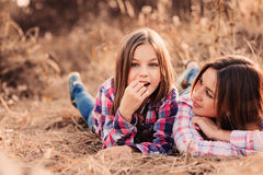 Happy mother and daughter on cozy walk on sunny field Stock Images