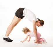 Happy mother and daughter doing sport exercises together Royalty Free Stock Image
