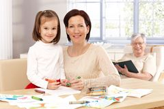 Happy mother and daughter drawing at home Stock Image