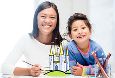 Happy mother and daughter drawing at home Stock Photography