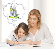 Happy mother and daughter drawing at home Stock Photos