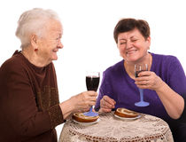 Happy mother with daughter drinking wine Royalty Free Stock Photography