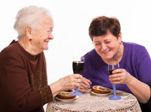 Happy mother with daughter drinking wine Royalty Free Stock Image
