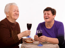 Happy mother with daughter drinking wine Royalty Free Stock Images