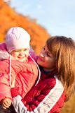 Happy mother with daughter enjoying a autumn day Royalty Free Stock Images