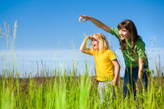 Happy Mother and Daughter on Field. Royalty Free Stock Photography