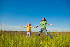 Happy mother and daughter on field Royalty Free Stock Photo