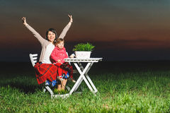 Happy Mother with Daughter in Field Royalty Free Stock Images