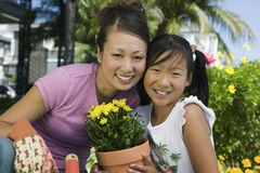 Happy Mother And Daughter Gardening Royalty Free Stock Photography