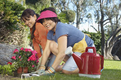 Happy Mother And Daughter Gardening Stock Photography