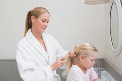 Happy mother and daughter getting ready Royalty Free Stock Images