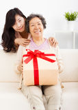 Happy mother and daughter with gift box Stock Images