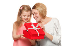 Happy mother and daughter with gift box, isolated on white background stock photo