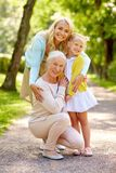 Happy mother, daughter and grandmother at park Stock Photography