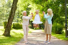 Happy mother, daughter and grandmother at park Royalty Free Stock Photos