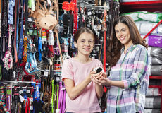 Happy Mother And Daughter With Guinea Pig In Pet Store Royalty Free Stock Photos