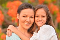 Happy mother and daughter. Posing on blurred background Royalty Free Stock Image