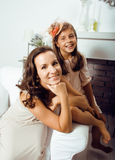 Happy mother with daughter at home Royalty Free Stock Image