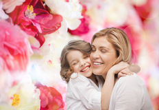 Happy mother and daughter hugging. Family, child and happiness concept - hugging mother and daughter Stock Photography