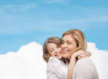 Happy mother and daughter hugging. Family, child and happiness concept - hugging mother and daughter Royalty Free Stock Images