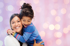 Happy mother and daughter hugging Royalty Free Stock Photography
