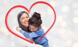 Happy mother and daughter hugging Royalty Free Stock Images