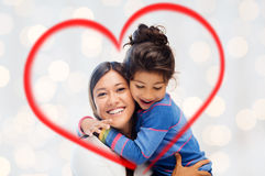 Happy mother and daughter hugging stock photos