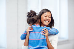 Happy mother and daughter hugging at home Stock Photography