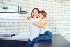 Happy mother and daughter are hugging in the home. Happy mother and daughter are hugging in the house. Mothers Day Royalty Free Stock Photos