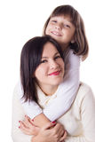 Happy mother and daughter hugging Stock Photo