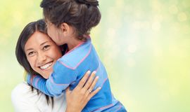 Happy mother and daughter hugging and kissing royalty free stock image