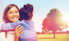 Happy mother and daughter hugging outdoors Royalty Free Stock Image