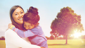 Happy mother and daughter hugging outdoors Royalty Free Stock Photos