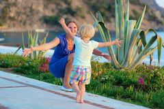 Happy mother and daughter hugging outdoors Stock Images