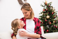 Happy mother and daughter. Hugging and smiling each other Stock Image