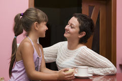 Happy mother and daughter indoor Royalty Free Stock Images