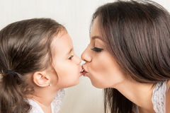 Happy mother and  daughter kissing Stock Photography