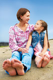 Happy mother and daughter laughing together outdoors Stock Photo