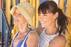 Happy mother and daughter looking away while Royalty Free Stock Photo