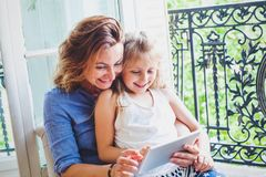Happy mother and daughter looking at digital tablet computer Stock Photography