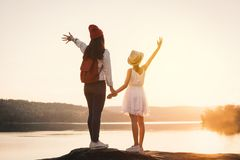 Happy mother and daughter looking at the sky during sunset. Relax time on holiday concept travel,selective and soft focus,color of hipster style Royalty Free Stock Photos
