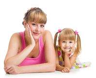 Happy mother and daughter lying on the floor Stock Images