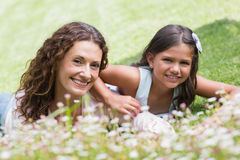 Happy mother and daughter lying on the grass Royalty Free Stock Images