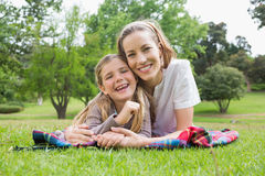 Happy mother with daughter lying at park Royalty Free Stock Image