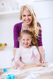 Happy mother and daughter making bread Stock Photography