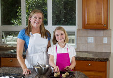 Happy mother and daughter making cookies Stock Image