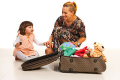 Happy mother and daughter making luggage Royalty Free Stock Photography